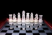foto of chessboard  - Glass chess on a glass stand chessboard - JPG