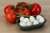 foto of shredded cheese  - Mozzarella cheese balls with onion and tomato branch - JPG
