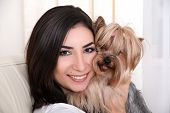 pic of hairy tongue  - Portrait of young beautiful woman playing with her dog - JPG