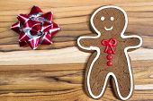 picture of gingerbread man  - holiday classic a gingerbread man cookie on a wooden table - JPG