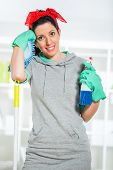 stock photo of cleaning agents  - Woman holding a cleaning spray in hand - JPG