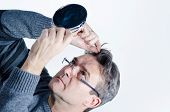 foto of dandruff  - Guy checking out his hair with a mirror - JPG