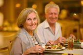 foto of elderly  - Portrait of beautiful elderly couple in restaurant  - JPG