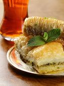 pic of baklava  - Turkish arabic dessert - baklava with honey and walnut, pistachios nuts