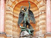 picture of michel  - The statue of Saint Michael atop the fountain in the Place Saint - JPG