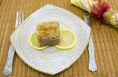 picture of baklava  - Juicy baklava on a plate decorated with lemon slices ready to be eaten - JPG