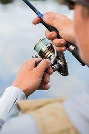 stock photo of fly rod  - Fishing in river - JPG