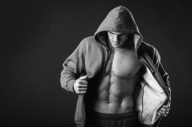 picture of jacket  - Young muscular man with open jacket revealing muscular chest and abs - JPG