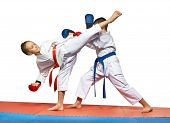 picture of karate  - Two young athlete doing exercise paired karate - JPG
