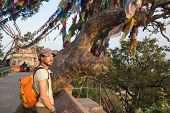 picture of buddhist  - A man near the Buddhist stupa  - JPG