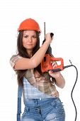 picture of hammer drill  - Young sexy female dressed in jeans and orange helmet holding hammer  electric drill - JPG