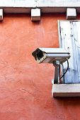 stock photo of cctv  - Brown grunge textured concrete wall with CCTV - JPG