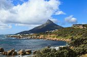 stock photo of mountain chain  - Beautiful Camps Bay Beach and Lion Head Mountain Chain Cape Town South Africa - JPG