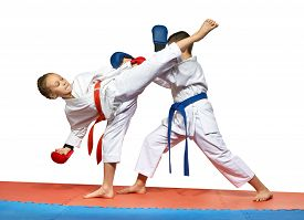 picture of karate-do  - Two young athlete doing exercise paired karate - JPG