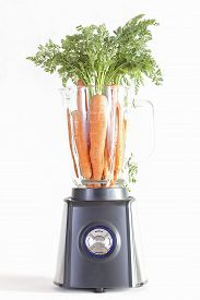 stock photo of blender  - Electric blender with carrots on a white background - JPG
