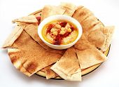 stock photo of flat-bread  - Hummus and traditional Arabian flat bread or qubus - JPG