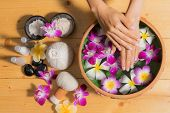 Woman Hands With A Bowl Of Aroma Spa Water Oil poster