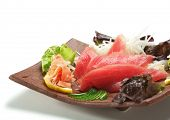 Tuna Sashimi - Maguro (fresh raw tuna) on Daikon (White Radish). Garnished with Ginger, Wasabi, Seaw