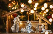 Christmas Manger Scene With Figurines Including Jesus, Mary, Joseph And Sheep. Focus On Mother! poster