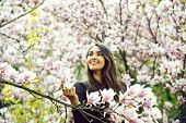 Beauty And Nature. Happy Girl Or Pretty Woman With Long, Brunette Hair Smiling At Magnolia Tree With poster