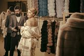 Woman In Fur Coat With Man, Shopping, Seller And Customer. Date, Couple, Love, Man And Woman. Purcha poster