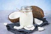 Coconut Milk In Glass Jar. Vegan Non Dairy Alternative Milk. Coconut Milk In Glass Jar. poster