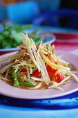 stock photo of green papaya salad  - Thai papaya salad hot and spicy mixed from variety of vegetable closeup also know as Som Tam - JPG
