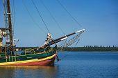 Large Sailing Wooden Ship Sails Through Beautiful Blue Water. poster