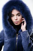 Girl Posing Hooded Fur Coat. Female With Makeup Wear Dark Blue Soft Fur Coat. Woman Wear Hood With F poster