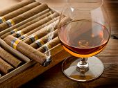 picture of cigar  - Cuban cigar and liquor drink on wood background - JPG