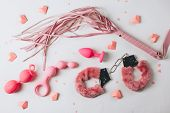 Various Pink Sex Toys Are Arranged On A White Background With Pink Hearts. Romantic Background For G poster