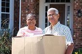 image of senior-citizen  - Senior Minority Couple With A Moving Box - JPG