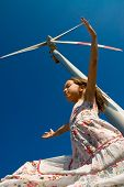 foto of dynamo  - girl playing in the wind under a turbine - JPG