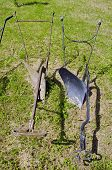image of horse plowing  - two old metal manual horse plow in farm - JPG