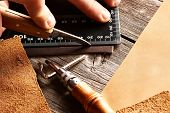 foto of leather tool  - Leather crafting tools still life - JPG