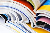 pic of piles  - Pile of colorful magazines  - JPG