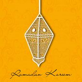 Muslim community holy month of Ramadan Kareem background with hanging intricate arabic lantern on or