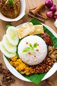 picture of nasi  - Nasi lemak kukus traditional malaysian spicy rice dish - JPG