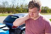 stock photo of driver  - Driver Suffering From Whiplash After Traffic Collision - JPG