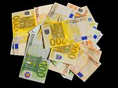 Different euro bills isolated in black