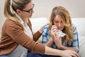 picture of crying  - Mother soothes sad teen daughter crying by problems - JPG