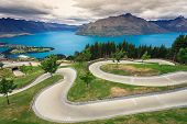 stock photo of luge  - Luge track with beautiful lake and mountain at Skyline Queenstown New Zealand - JPG