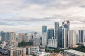 stock photo of kuala lumpur skyline  - The Kuala Lumpur skyline continues to expand under heavy construction - JPG