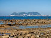 stock photo of gibraltar  - View from the rocky coast of the Parque de Centenario Algeciras Andalusia Spain to the rock of Gibraltar - JPG