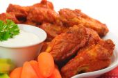 stock photo of chicken wings  - Spicy hot buffalo chicken wings shot closeup - JPG