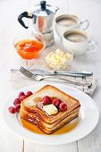 stock photo of french toast  - French toast with raspberries maple syrup and butter - JPG