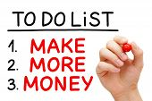 stock photo of writing  - Hand writing Make More Money in To Do List with red marker isolated on white - JPG