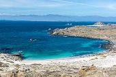 stock photo of shiting  - White sand and turquoise and blue water at Damas Island in Chile - JPG