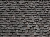 stock photo of shingles  - Old weathered wooden shingles continue being used as roofing material.