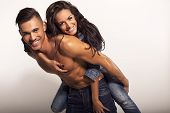 picture of nudity  - fashion photo of beautiful smiling couple wearing jeans - JPG